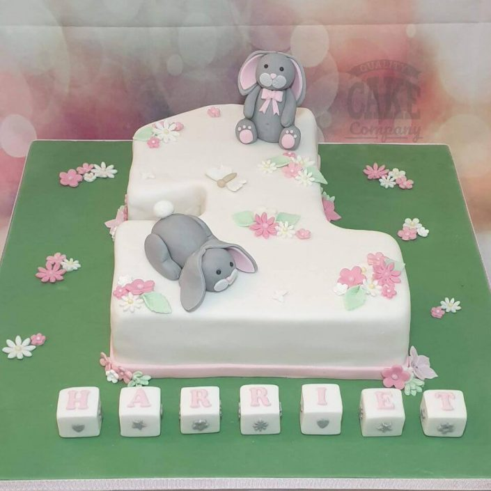 two cute bunnies on 1st birthday cake shaped like a 1 tamworth