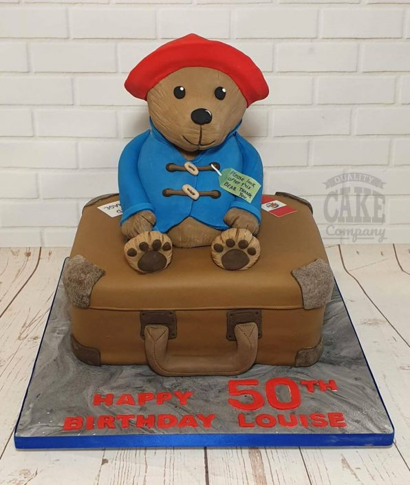 Paddington bear sitting on suitcase 50th birthday cake - tamworth