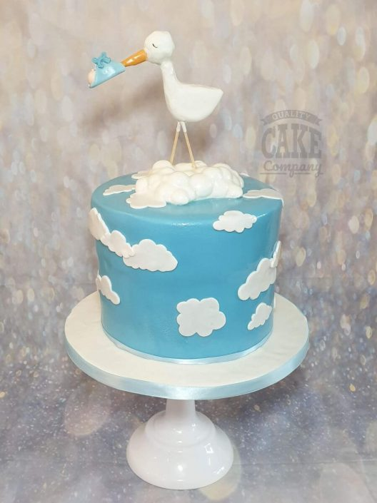 stork delivering baby in the clouds baby shower cake - tamworth