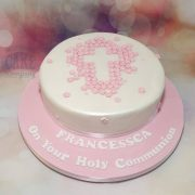 pretty christening cake with cross made from flowers - tamworth