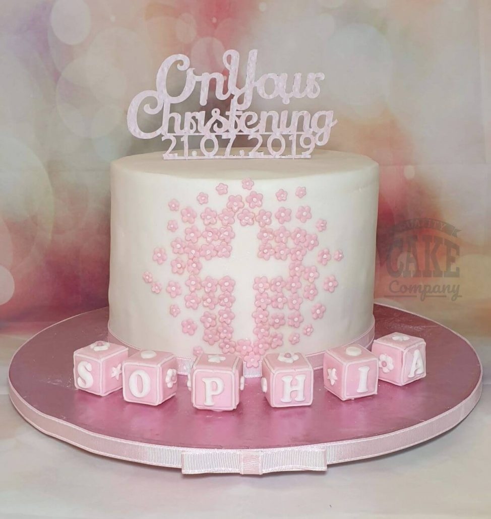 pretty christening cake with cross made from flowers and cute blocks - tamworth