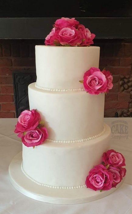 Three-tier simple wedding cake with pink roses - tamworth west midlands