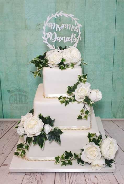 Three tier square white wedding floral cake with ivy and white roses - tamworth west midlands