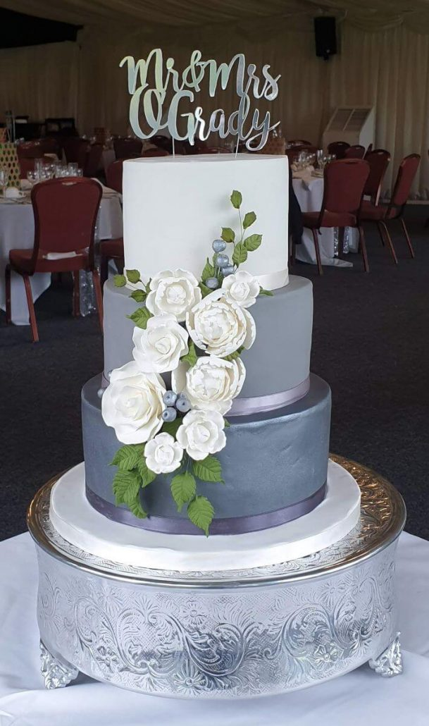 Three tier ombre wedding cake greys and silvers with white peonies