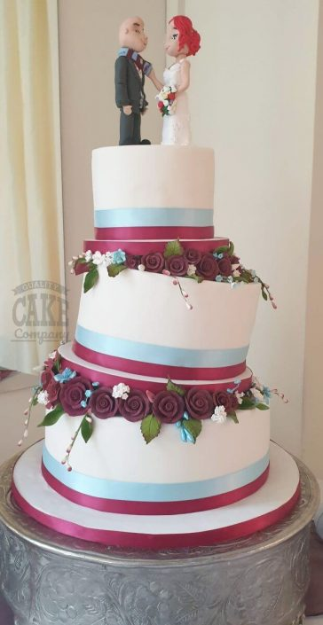 Three tier claret and blue topsy turvy wedding cake - tamworth west midlands