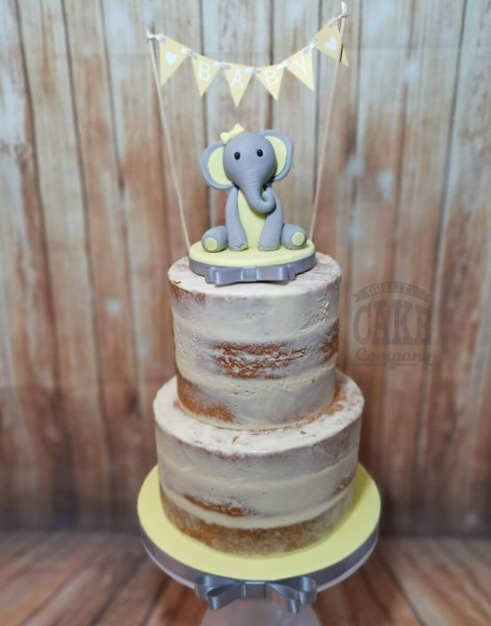 rustic semi naked cake soft colours yellow