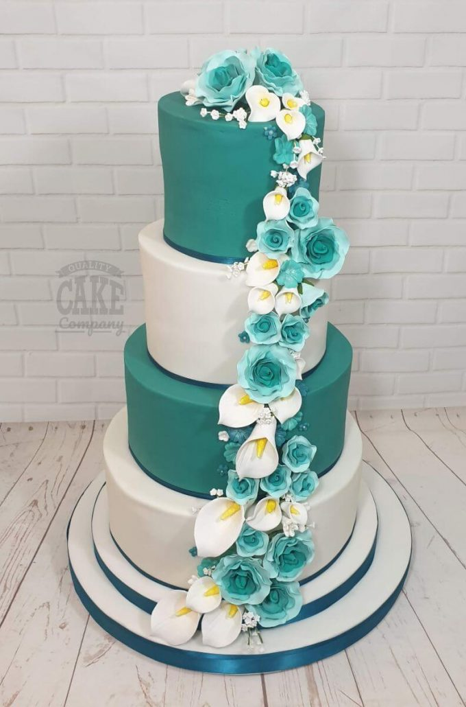 teal four tier wedding cake