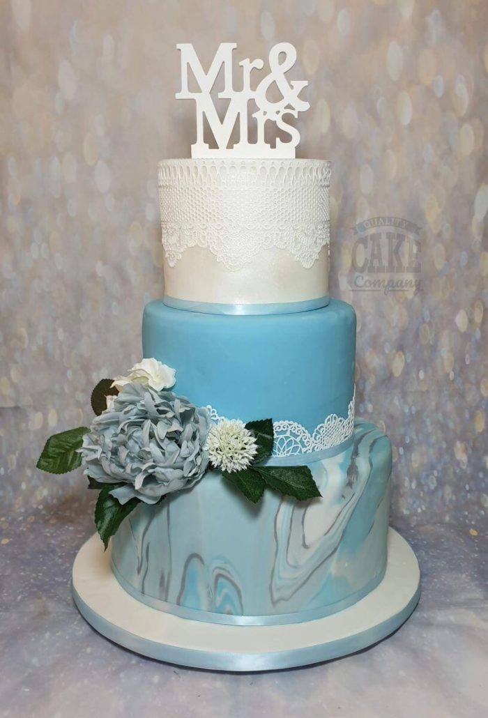 blue marble wedding cake with silk flowers