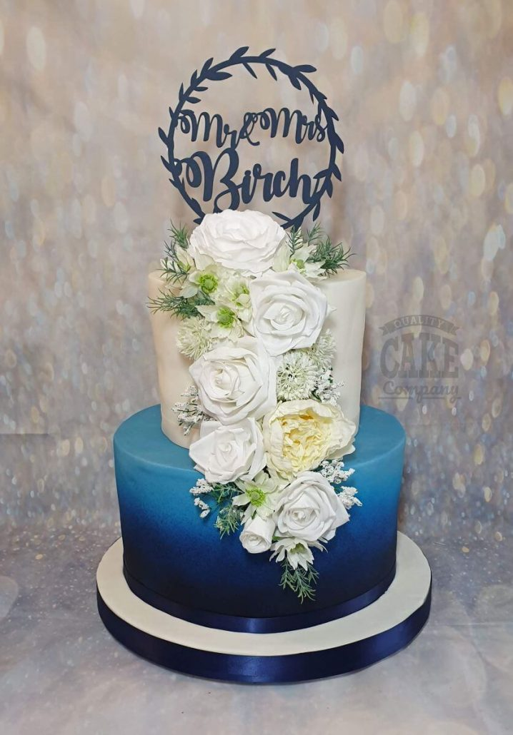 blue ombre cake with with silk flower roses