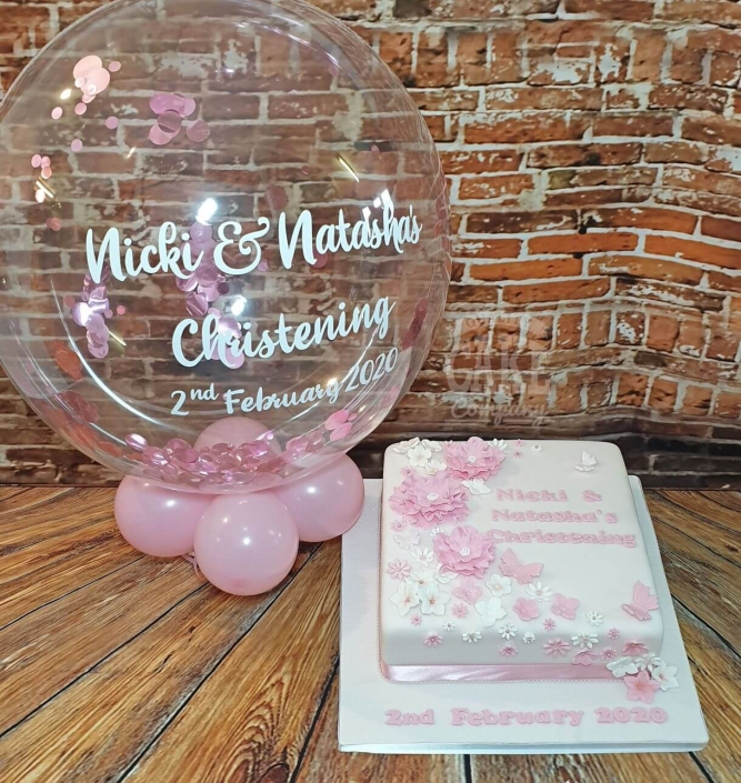 Floral pink Christening cake with matching bubble balloon