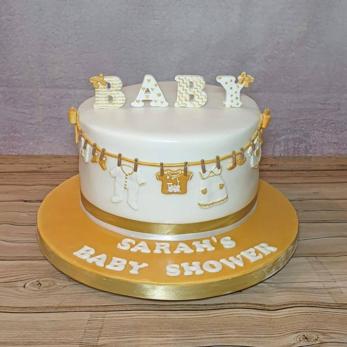 Gold and ivory baby shower washing line cake