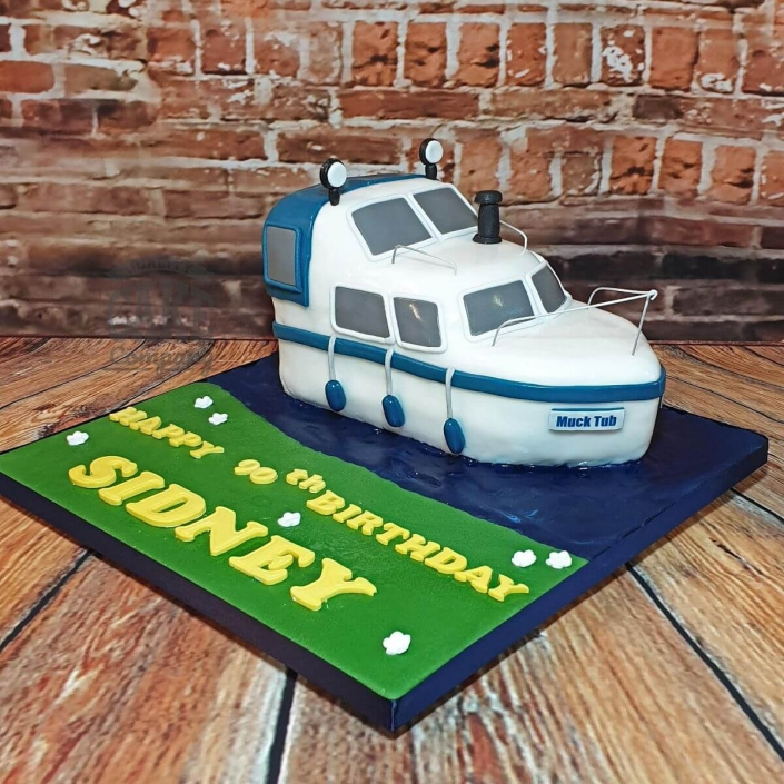 Riverboat novelty shaped cake