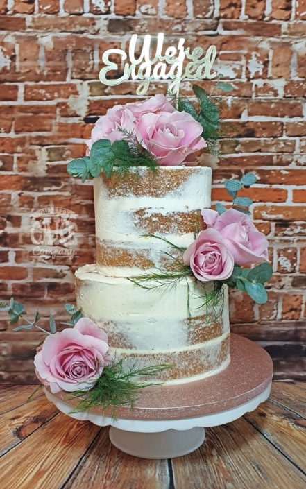 Two-tier semi-naked buttercream cake with roses - Tamworth