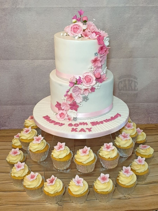 Two tier pink floral cake birthday cake and matching cupcakes - Tamworth