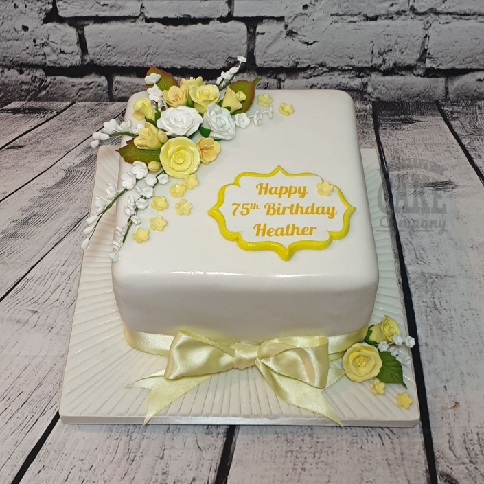 Yellow floral 75th birthday cake