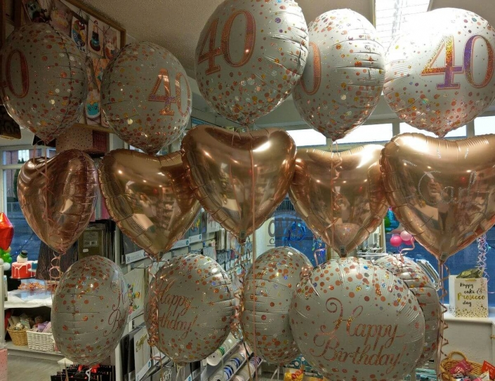 Bunches of rose gold 40th birthday balloons - tamworth