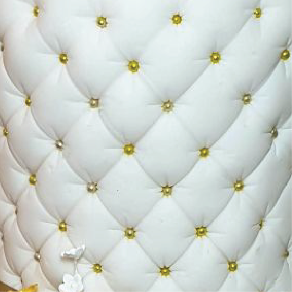 Gold and white quilted cake texture