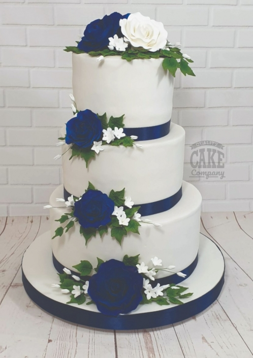 Three-tier wedding cake with blue roses - Tamworth
