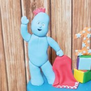 Fondant sugar branded figure standing Iggle Piggle custom cake decoration