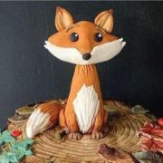 Fondant sugar detailed fox cake decoration