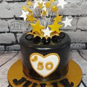 Modern black and gold starburst 50th birthday cake - Tamworth