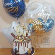 Modern blue and gold drip cake & matching birthday balloons - Tamworth