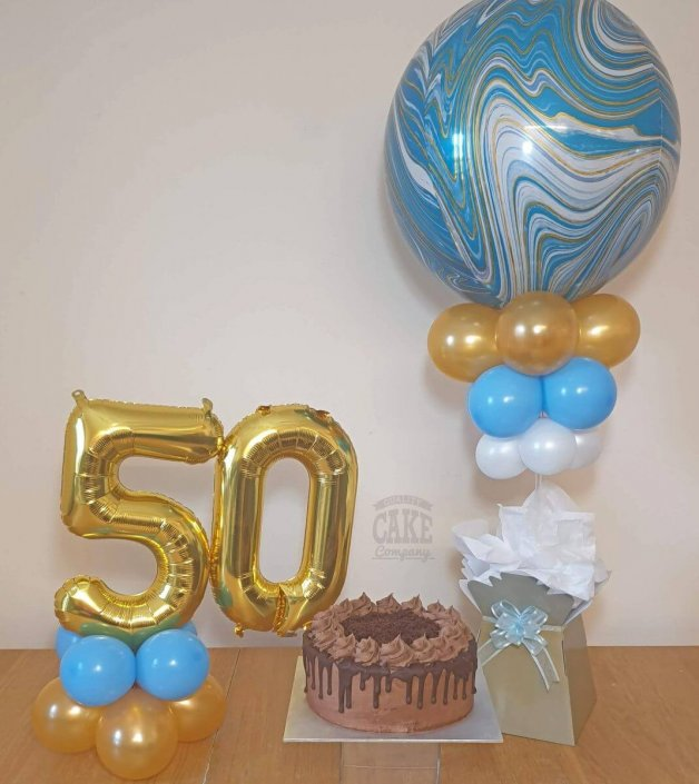 Balloon and cake table displays - blue and gold theme